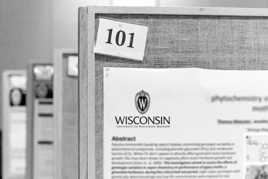 Black and White photo of a poster session from UW-Madison