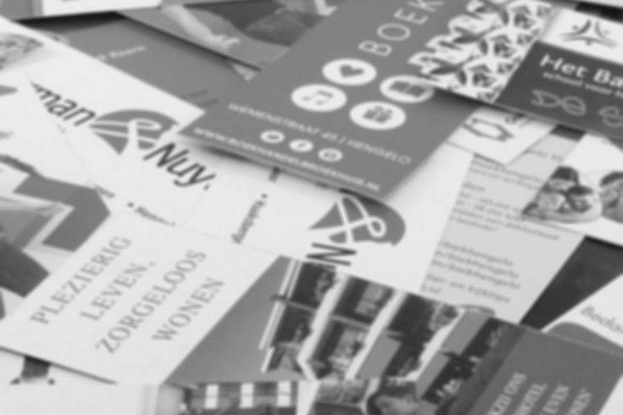Black and white image of print materials, such as fliers and brochures, text in german