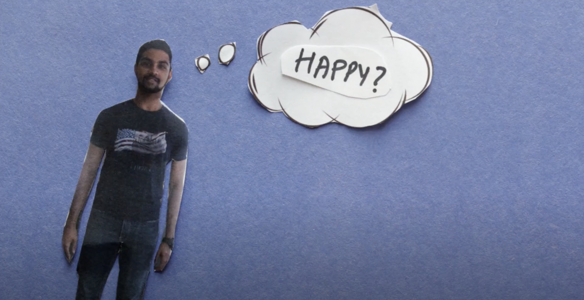 """Screenshot from a video, featuring a male student with a thought bubble that reads, """"Happy?"""""""