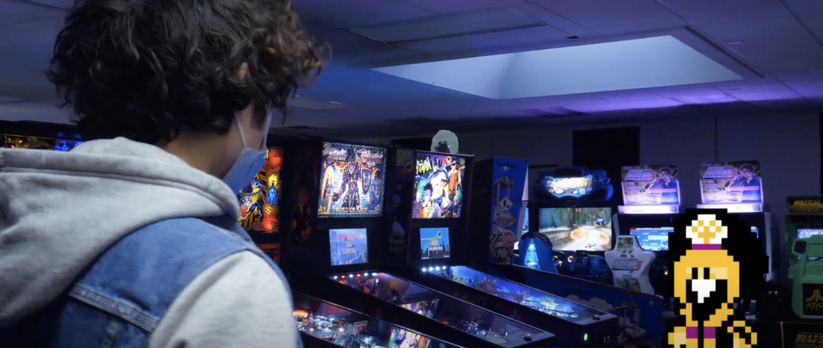augmented reality view of a video game character in an arcade, as viewed over the shoulder of a real person